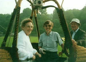 Picture of balloon basket with pilot, mother and family friend